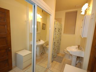 Capitol Hill apartment photo - Bath includes tub & shower combination, laundry located in the mirrored closet