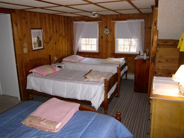 Bedroom #2 with two twin beds and one double bed.