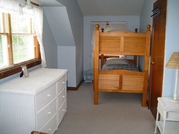 "Bunk beds and 6 drawer dresser in upstairs ""Sky"" bedroom."