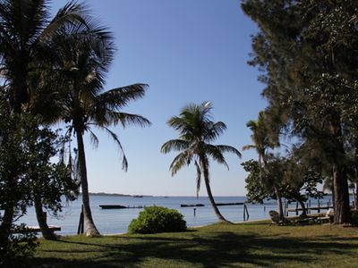 View of Manatee River from back yard - notice seating around a firpit!!