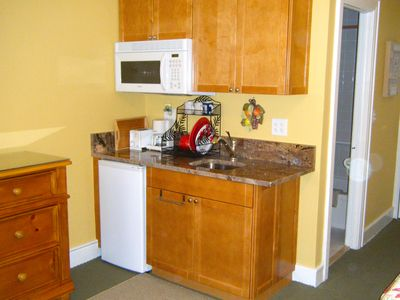 Kitchenette with Micro, fridge, toaster and coffee maker, granite counter