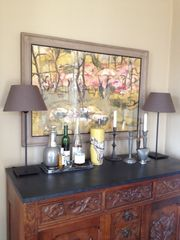 Rhinebeck house photo - 1950s watercolor hangs above a carved walnut sideboard used as a bar