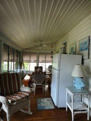 Virginia Beach cottage photo - Sun Porch Dining Area with Picnic Table and second refrigerator.