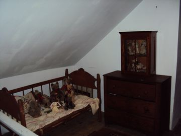 child's bed in upstairs hallway
