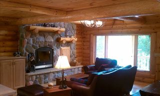 Burns Lake cabin photo - Lazy in luxury by the 24' tall wood-burning fireplace in great room