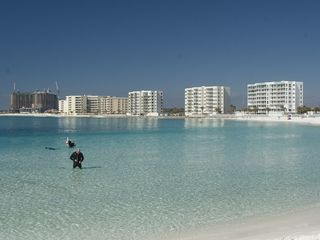 Our condo is just behind the snorkeler. Great beach for toddlers. - Destin condo vacation rental photo