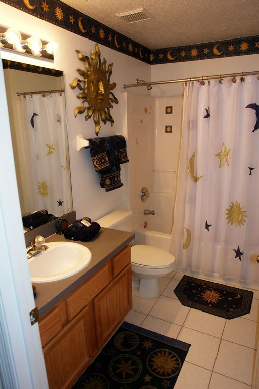 Third bathroom with bath and shower