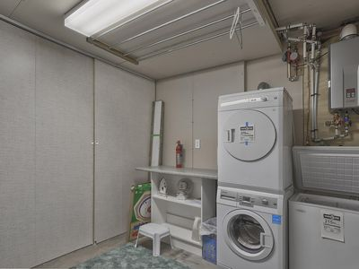 Laundry room is located in the basement with a place to hang wet sports clothing