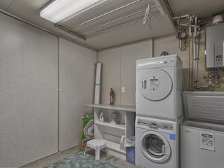 Victoria house photo - Laundry room is located in the basement with a place to hang wet sports clothing