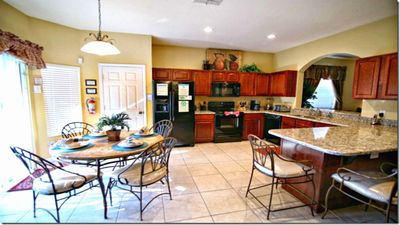 Granite counters with breakfast bar. Seats 7, dishwasher, microwave, etc.