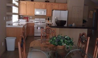 Kitchen with all appliances, microwave, double door fridge, ice and water
