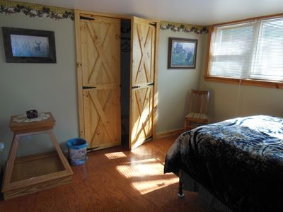 Pine Unit bedroom with a large closet has bright afternoon sunshine filtering in