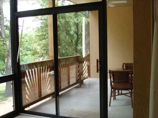 Branson condo photo - Glass enclosed room and covered deck