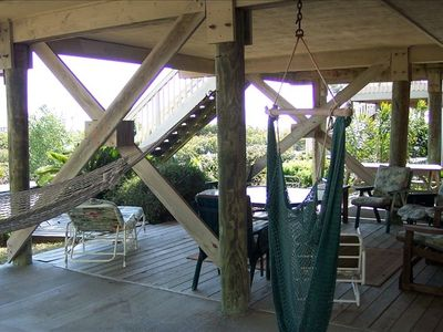 Hammock, tiki bar, lounger, and picnic table downstairs for casual hang-out area