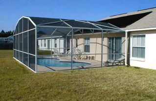 Briargrove villa photo - The villa has a 28ft by 14ft floodlit solar heated swimming pool