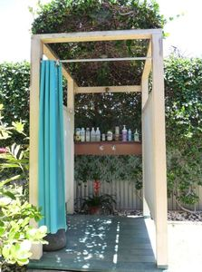 Wonderful outdoor shower with hot/cold water and lots of body products