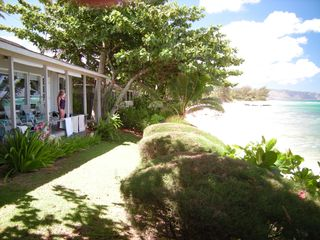 Haleiwa house photo - Front Porch feet from the beach as viewed from the cottage