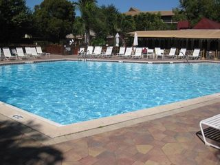 Naples condo photo - Heated Pool/Island Pub Restaurant