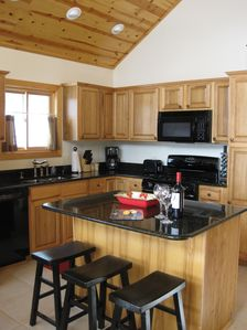 Entertain in the kitchen with granite counter tops & hickory cabinets