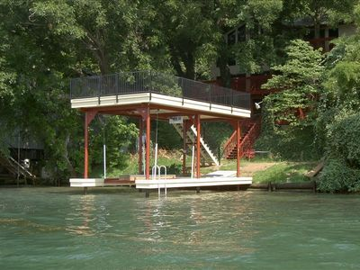 Private boat dock on Lake Austin with boat lift and deck above
