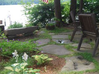 Norway cabin photo - Stone bench and gardens on the lake