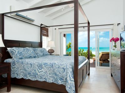 Master king suite with wall of sliding glass doors and gorgeous ocean views