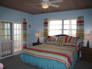 Bedroom 1 offers king bed, bathroom en suite, and excellent ocean views. - Spanish Wells villa vacation rental photo