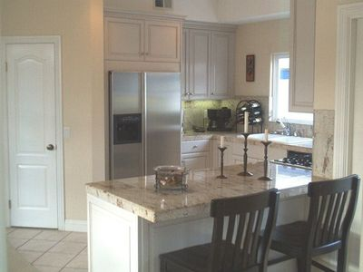 Beautiful kitchen with stainless steel appliances and granite countertops