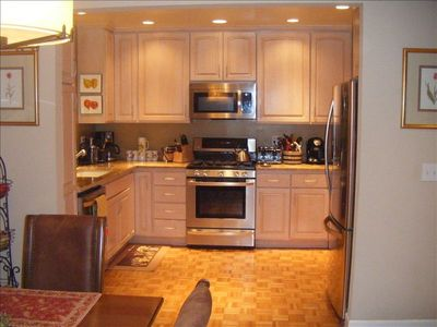 Recently remodeled kitchen with granite counters, and all new SS appliances.
