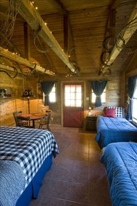 Cabin One -  Sleeps a King and Two Twins.   Shower Bath.  Kitchenette