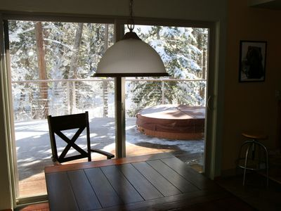 Christmas Valley house rental - view through the sliding door to the deck and the spa