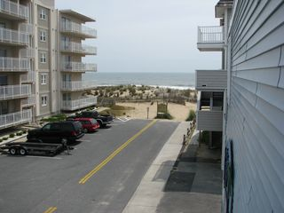 Dominica Beach Ocean City condo photo - View of beach from side of building - very close!