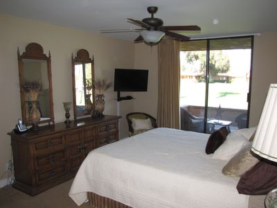 Master bedroom has new california king size bed and flat screen TV