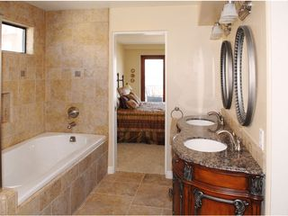 Mission Beach condo photo - Master suite bathroom with double sinks and walk in closet.
