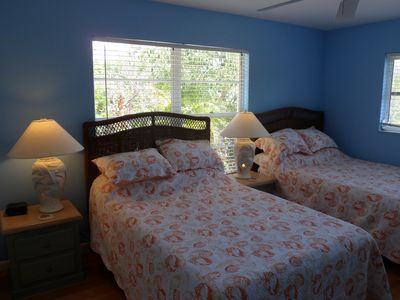 The colorful Second Guest Bedroom is spacious with two full or double beds!