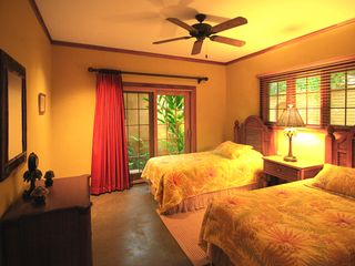Playa Langosta condo photo - The guest bedroom opens onto its own, private, garden-patio.