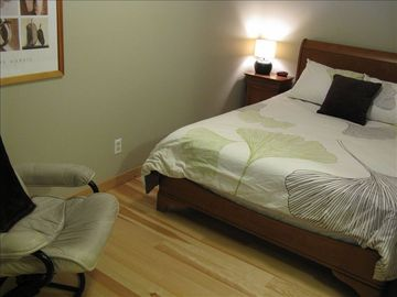 L-shaped bedroom with queen bed.