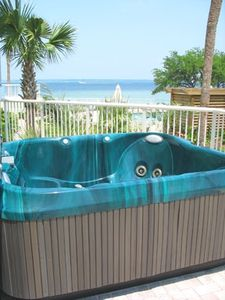 Relax in our 4 person private hot tub overlooking the bay, pool and Lazy River!