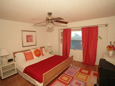 This Downstairs Bedroom features a King Bed, TV and Some Beach View thru Dunes