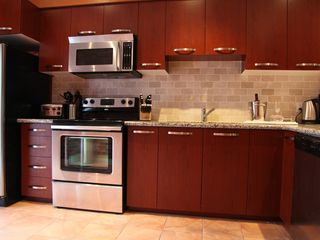 Toronto house photo - kitchen with modern appliances - Jura coffee maker