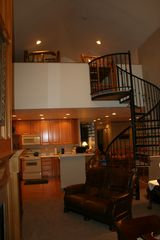 Midway condo photo - Spiral staircase climbs to sleeping loft.