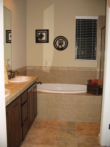 Master bathroom, glass shower beside tub