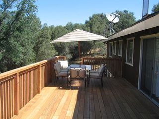 Oakhurst house photo - Main Area of 600+ wrap around, iron wood deck