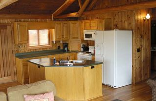Huddleston cabin photo - Well equipped kitchen opens up into the great room. Even here, you are never far