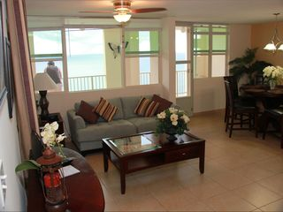 Aguadilla condo photo - Living room and dining room.