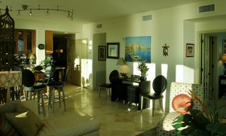 Navarre Beach condo photo - Travertine tile and custom lighting; bar tables and breakfast bar seat 8!