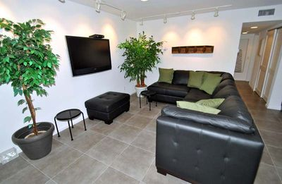 Living Room with flat screen televsion and comfortable leather sectional sofa.