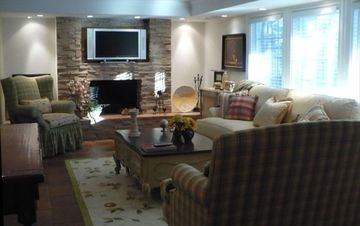 Guest living room with wide screen TV & fireplace