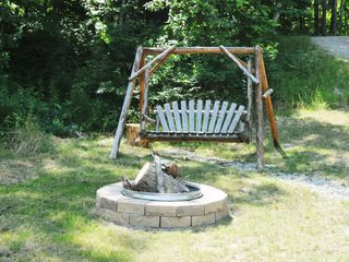 Burt Lake cabin photo - Your Private Fire Pit for those memory making nights...Log Swing...Free Wood...