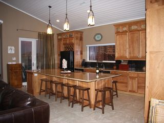 Pensacola Beach house photo - Kitchen with two ovens, two dishwashers, bar seating, two refrigerators.